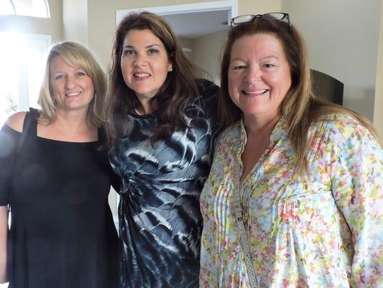 From left are Julie Kroeger, GAL Volunteer, Roberta