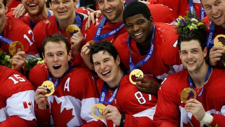 Team Canada celebrates after beating Sweden in the gold medal game.