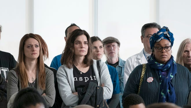 Marin Ireland, from left, Betsy Brandt and Jill Scott stand up to speak out about the unsafe water in Flint, Mich.