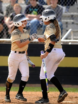 Abilene High's Cierra Woodyard (2) is congratulated by teammate Kaylen Washington (8) after Davila scored in the bottom of the sixth inning of the Lady Eagles' 6-3 win on Wednesday, March 29, 2017, at Abilene High School.