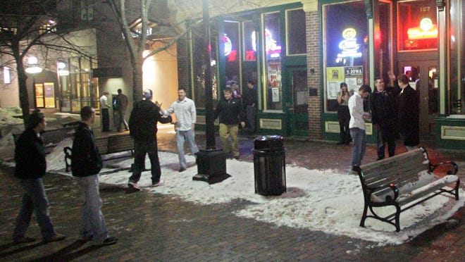 People gather near the Union Bar on the pedestrian mall in downtown Iowa City on Feb. 4, 2010.