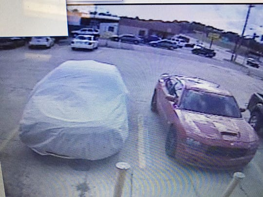 Police are seeking the owners or driver of this red Dodge Charger.