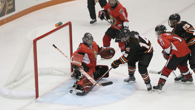 RIT forward Mackenzie Stone (14) applies pressure in front goal in last week's 9-0 win over the Ottawa Lady Senators in an exhibition game at the Gene Polisseni Center.