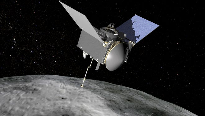 In this artist concept image, OSIRIS-REx extends its sampling arm as it moves in to make contact with the asteroid Bennu.
