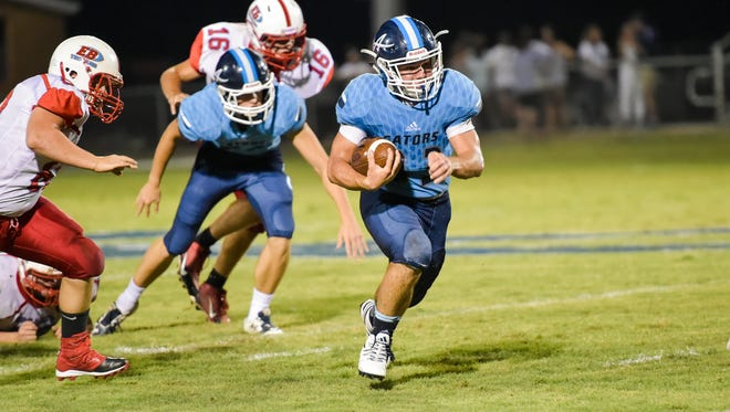 Leo Franques runs for a touchdown as the Ascension Blue Gators take on the Trojans from East Beauregard on Friday.