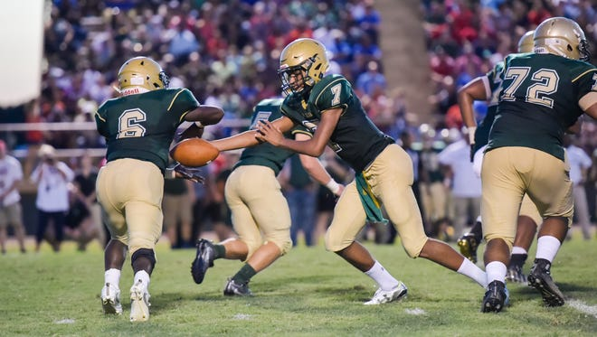 Quarterback Jaylen Borel hands off to Ziggy Francis as the Acadiana Wrecking Rams hosts Ponchatoula in home football opener.