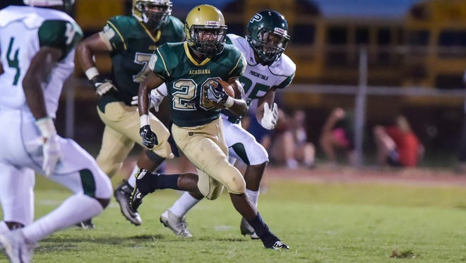 Acadiana running back Myles Hutchinson breaks a tackle to score a touchdown during the Rams' 24-23 loss to Ponchatoula on Friday.