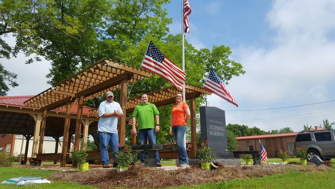 Home  Depot's  Alex Grieshop, Jon Minton and Kristen Jackson look forward to helping keep Pike Road's Veterans Memorial maintained for the community and veterans.