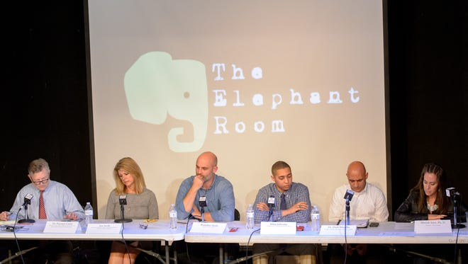 Panelists participate in The Elephant Room on Monday.