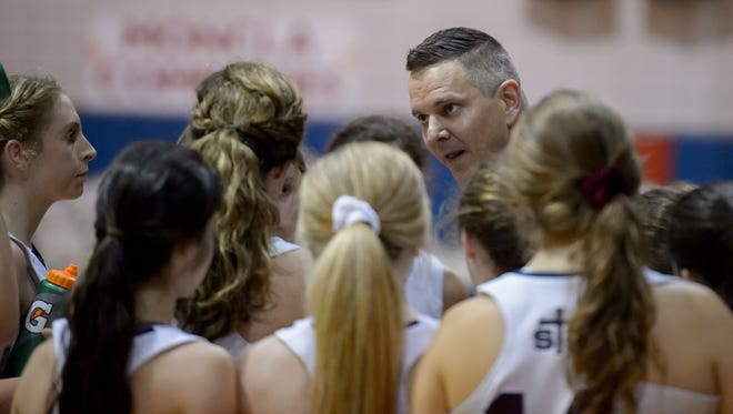 Head Coach Stephen Strojny talks to his team during a time out as STM takes on  Loyola Prep in the quarterfinals girls basketball playoffs.  Thursday, Feb. 23, 2017.