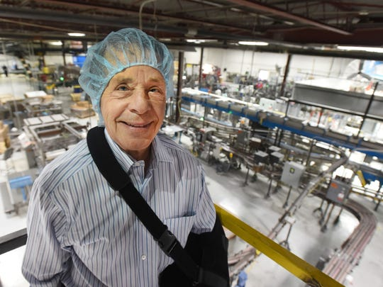 """Chelsea Milling Company and Jiffy Foodservice LLC President and CEO Howard """"Howdy"""" Holmes, despite having recent shoulder surgery, shows off the Jiffy corn muffin mix boxing area."""