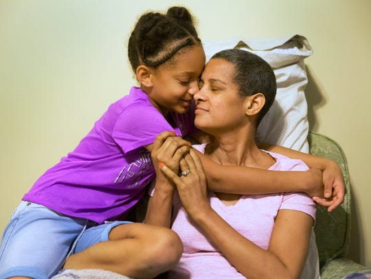 Camille, 9, has a moment with her mom, Pamela Smitherman, 46, before school.