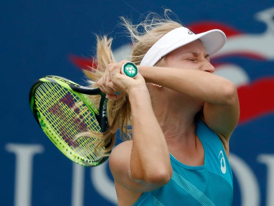 Daria Gavrilova, of Australia, returns a shot from Shelby Rogers, of the United States, during the second round of the U.S. Open tennis tournament, Thursday, Aug. 31, 2017, in New York. (AP Photo/Adam Hunger)