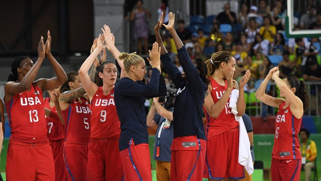 Aug 14, 2016; Rio de Janeiro, Brazil; USA celebrates after defeating China in the women's preliminary round in the Rio 2016 Summer Olympic Games at Youth Arena.