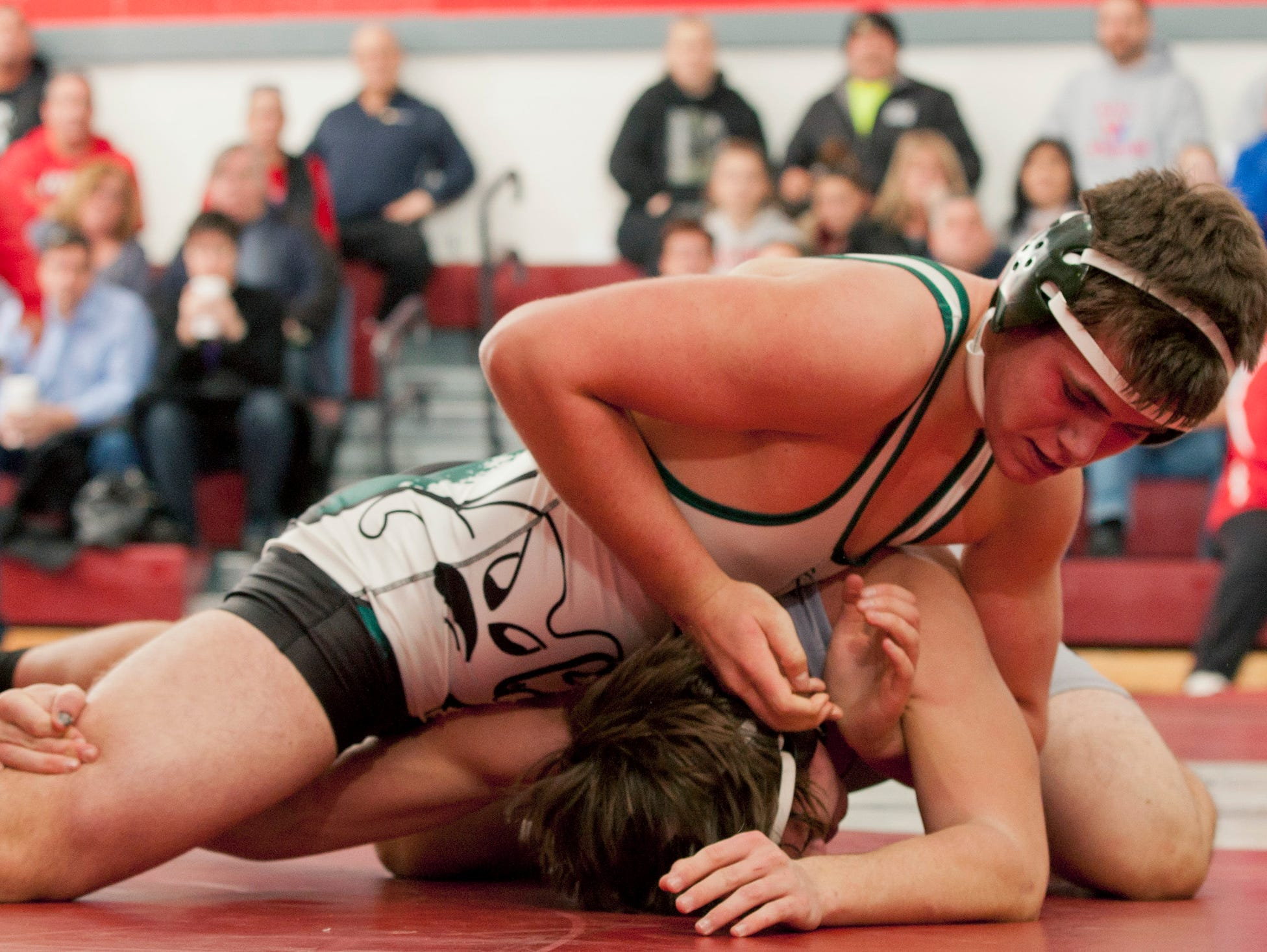 Long Branch's Pete Wersinger defeated Wall's Kye Dallicardillo 9-3 in their 182 lbs. match. Long Branch vs Wall Wrestling on January 10, 2015. Peter Ackerman/Staff Photographer
