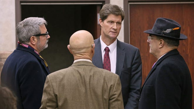 December 16, 2016 Former Milwaukee Police Officer Dominique Heaggan-Brown in Milwaukee County Intake Court be charged with first-degree reckless homicide in fatal shooting of Sylville Smith. Before the proceeding, Heaggan-Brown attorneys Jonathan Smith (left) and Steven R. Kohn (right) speak with Milwaukee County Dist. Attorney John T. Chisholm (center facing camera).