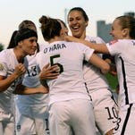 Midfielder Carli Lloyd (10) celebrates her goal with teammates during the second half in the quarterfinals.