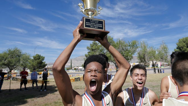 Austin High School's Eric Hunt celebrates with the first place team trophy last month after the Panthers won the District 1-5A Cross Country Championship for a third straight year. Hunt and his Austin teammates will compete in the Class 5A state cross country meet this weekend.
