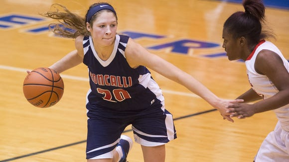 Roncalli High School senior Lindsey Corsaro (20) works the ball around the court during the second half of the championship game in the Girl's Marion County Basketball Tournament, Saturday, Dec. 12, 2015, at Franklin Central High School. Roncalli won the game 66-52.