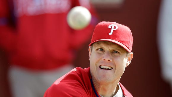 Philadelphia Phillies relief pitcher Jonathan Papelbon throws a pitch during spring training baseball practice Thursday, Feb. 13, 2014, in Clearwater, Fla. (AP Photo/Charlie Neibergall)