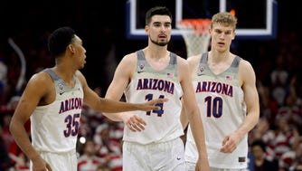 Feb 8, 2017: Arizona Wildcats guard Allonzo Trier (35) and center Dusan Ristic (14) and forward Lauri Markkanen (10) walk up court during the second half against the Stanford Cardinal at McKale Center. Arizona won 74-67.