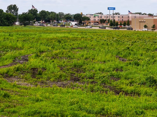 The site of the new Costco warehouse with a liquor store and gas station shown Thursday, June 28, near the Stearns History Museum.
