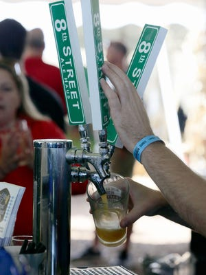 A beer is poured from the taps of the 8th Street Ale Haus Saturday September 24, 2016 at the Blue Harbor Craft Beer Festival in Sheboygan.
