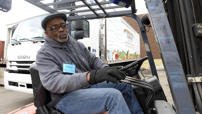 Veteran Melvin Freeman Jr. learns how to operate fork lifts at the Forgotten Harvest Distribution Center in Oak Park last month.