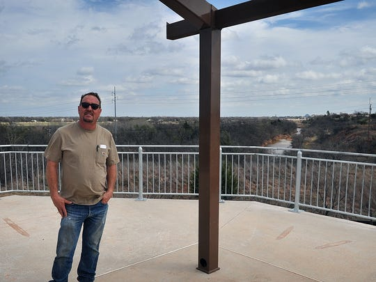 Inspector Mark Hamett describes the construction of one of two pavilions being built along the Circle Trail in the Wichita Bluff Nature Area. After the pavilions, overlooks, benches and several retaining walls are built, paving of the sidewalk area can begin.