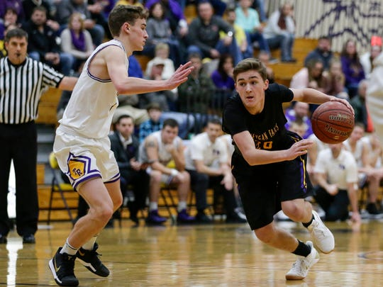 Sheboygan Falls' Jonah Tenpas (20) drives to the hoop against Two Rivers at Two Rivers High School Friday, Jan. 19, 2018, in Two Rivers, Wis. Josh Clark/USA TODAY NETWORK-Wisconsin
