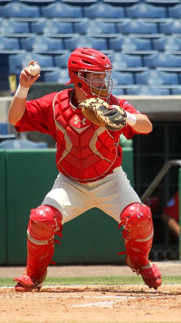 Andrew Knapp catches for the Clearwater Threshers in May.