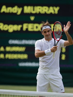 Roger Federer of Switzerland beat Andy Murray of Great Britain 7-5, 7-5, 6-4 in their Wimbledon semifinal match.