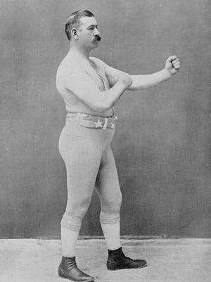 Irish-American boxer John L. Sullivan is considered the first heavyweight champion of gloved boxing. He held the title from Feb. 7, 1882, to Sept. 7, 1892, and is the last heavyweight champion to fight bare-knuckled.