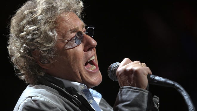 Roger Daltrey sings for the crowd as The Who plays the KFC Yum! Center. Feb. 16, 2013