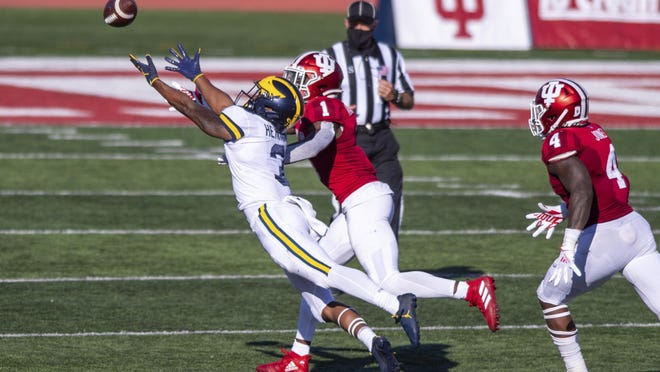 Michigan wide receiver A.J. Henning (3) makes a diving effort for the ball as he's defended by Indiana defensive back Devon Matthews (1) during the second half of Saturday's game, in Bloomington, Ind. Indiana won 38-21.