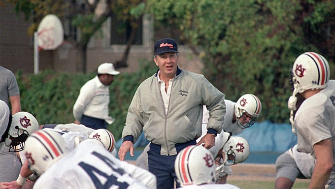 Auburn coach Pat Dye walks through his players as they begin workouts in preparation for the 1988 Sugar Bowl.