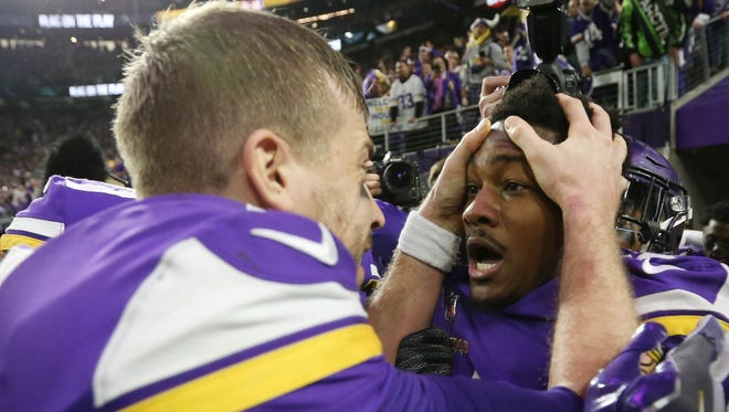 Minnesota's Stefon Diggs (right) celebrates with quarterback Case Keenum after the game-winning touchdown against New Orleans.