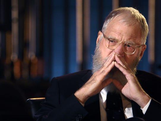 David Letterman listens to former President Obama on