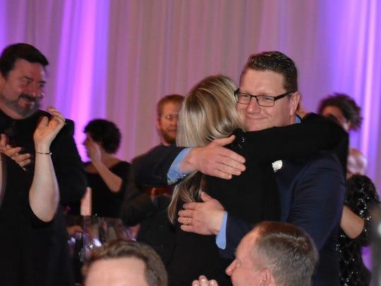 Darren Eisele of Hood Canal Communications hugs someone