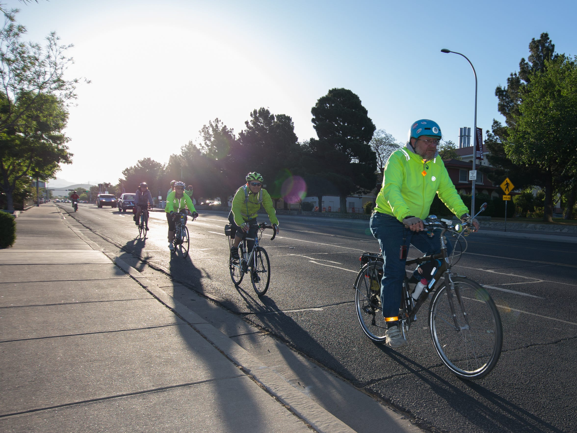 George Pearson, certified instructor of the League of American Bicyclists leads a line of cyclists on the Share the Road Visibility Ride down University Avenue.