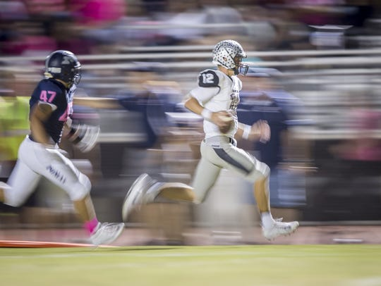 Hamilton quarterback Tyler Shough (12) runs the ball