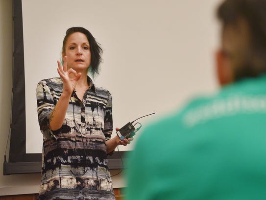 Angela Elsner-Brown speaks at the New Approach SD meeting