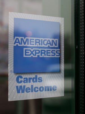 File photo taken in 2008 shows the American Express logo outside of a Des Plaines, Illinois restaurant.