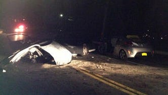 The remnants of two cars after Michael Coyle crashed his car into a Hyundai Veloster on Friday, Feb. 22, 2013.