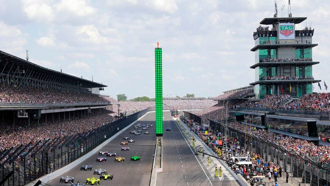 From May 27, 2018, Ed Carpenter leads the field into the first turn on the start of the Indianapolis 500 auto race at Indianapolis Motor Speedway in Indianapolis. The speedway is closed due to the coronavirus pandemic.