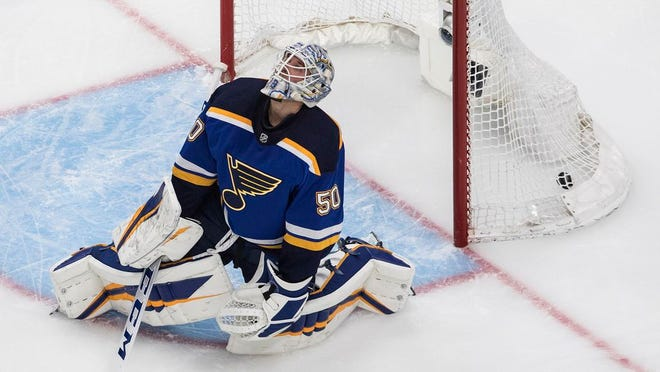 St. Louis Blues goalie Jordan Binnington reacts after giving up a goal to the Vancouver Canucks during the third period in Game 1 of an NHL hockey Stanley Cup first-round playoff series, Wednesday, Aug. 12, 2020, in Edmonton, Alberta.