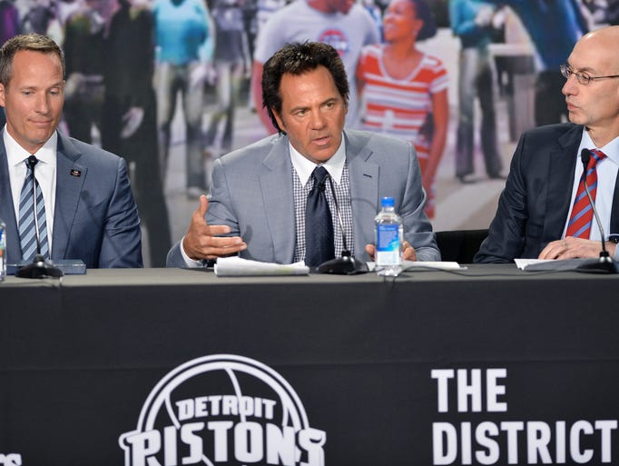 Detroit Pistons owner Tom Gores, center, talks  during