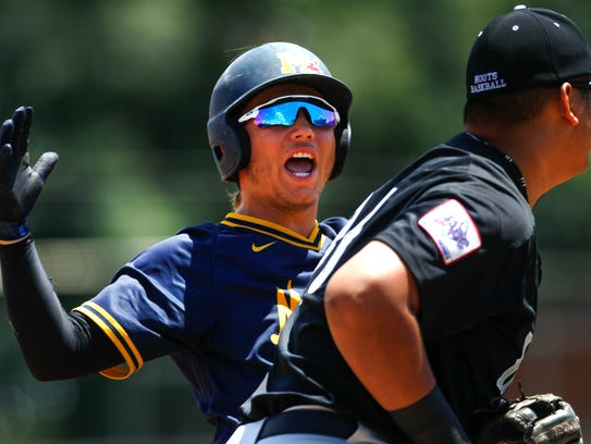 Midland Redskins baserunner Cal Conley reacts after