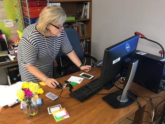 Marsha Hammack double checks her computer before beginning her first day with students at McMurry University's magnet school Monday, Aug. 28, 2017.