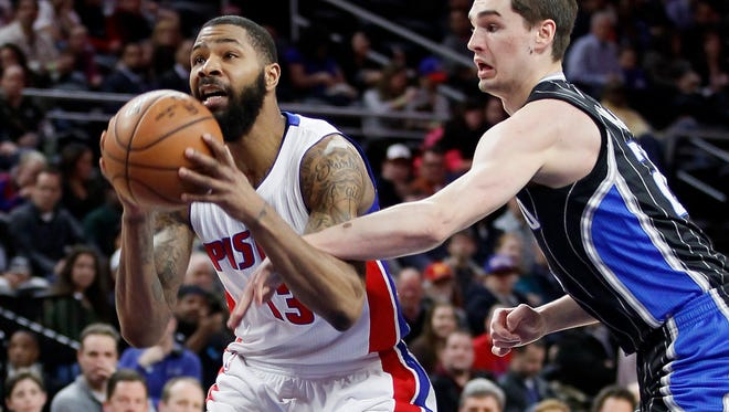 Pistons' forward Marcus Morris (13) is fouled by the Magic's Mario Hezonja while going to the basket during the first half Wednesday at the Palace.